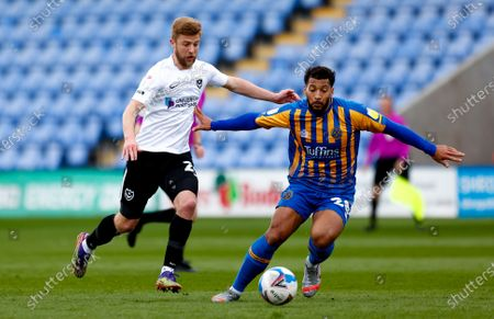 Portsmouth midfielder Michael Jacobs (24) and Shrewsbury Town midfielder David Davis (28)  during the EFL Sky Bet League 1 match between Shrewsbury Town and Portsmouth at Montgomery Waters Meadow, Shrewsbury