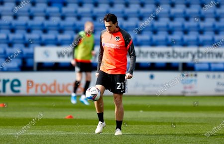 Portsmouth defender Charlie Daniels (21)   warming up  during the EFL Sky Bet League 1 match between Shrewsbury Town and Portsmouth at Montgomery Waters Meadow, Shrewsbury