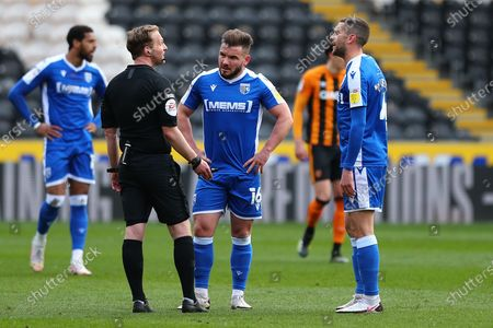 Referee speaks to Alexander MacDonald and Stuart O'Keefe  during the EFL Sky Bet League 1 match between Hull City and Gillingham at the KCOM Stadium, Kingston upon Hull