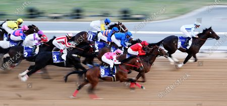 Stock Image of Jockey Mickael Barzalona on Panadol from the USA (R) in front of the pack during the UAE Derby race at the Dubai World Cup in Dubai, United Arab Emirates, 27 March 2021. Panadol placed second in the end.
