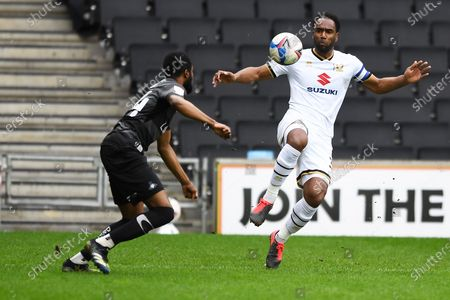 Doncaster defender Cameron John (24) and MK Dons' Forward Cameron Jerome (35) battles for possession during the EFL Sky Bet League 1 match between Milton Keynes Dons and Doncaster Rovers at stadium:mk, Milton Keynes