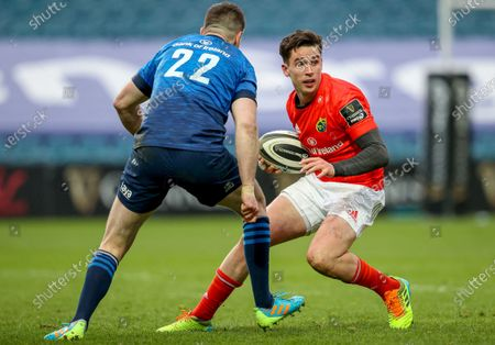 Leinster vs Munster. Munster's Joey Carbery comes up against Johnny Sexton of Leinster