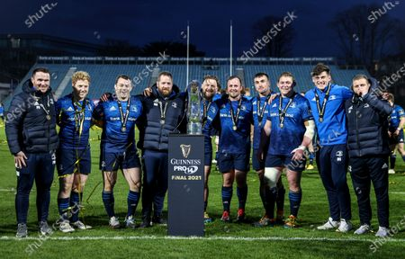 Stock Photo of Leinster vs Munster. Leinster Front-rows Peter Dooley, James Tracy, Cian Healy, Michael Bent, Andrew Porter, Ed Byrne, Ronan Kelleher, Tadhg Furlong, Dan Sheehan and Sean Cronin celebrate with the Guinness PRO14 trophy
