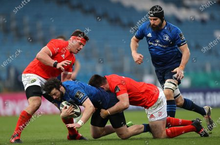 Leinster vs Munster. Munster's CJ Stander and Niall Scannell tackle Robbie Henshaw of Leinster