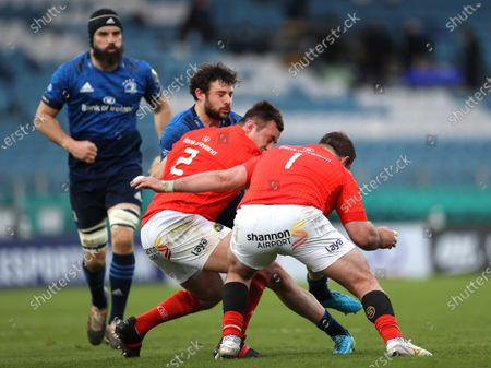 Leinster vs Munster. Munster's Niall Scannell and James Cronin tackle Robbie Henshaw of Leinster