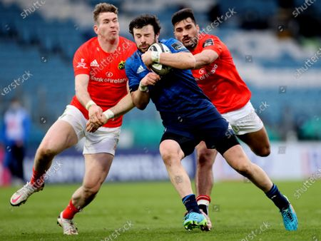 Leinster vs Munster. Leinster's Robbie Henshaw tackled by Chris Farrell and Damian De Allende of Munster