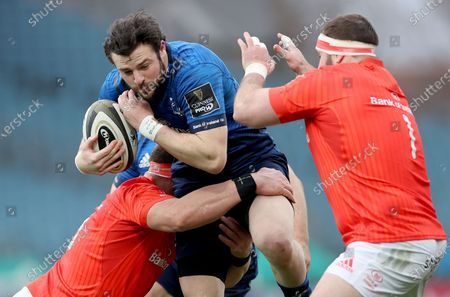 Leinster vs Munster. Munster's CJ Stander and James Cronin tackle Robbie Henshaw of Leinster