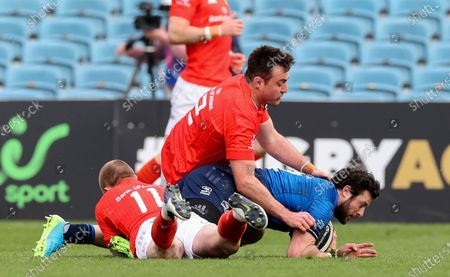 Leinster vs Munster. Leinster's Robbie Henshaw is tackled by Keith Earls and Niall Scannell of Munster