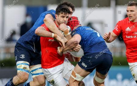 Leinster vs Munster. Munster's Conor Murray is tackled by Jack Conan and Josh Van der Flier of Leinster