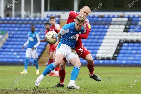 Sammie Szmodics of Peterborough United battles with David Morgan of Accrington Stanley