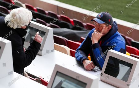 Stuart Hooper Bath's Director of Rugby chats with someone in the press box