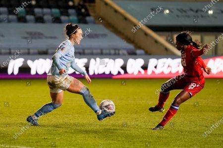 Manchester City Women defender Lucy Bronze (20) and Reading Women forward Danielle Carter (18) in action during the FA Women's Super League match between Manchester City Women and Reading LFC at the Sport City Academy Stadium, Manchester