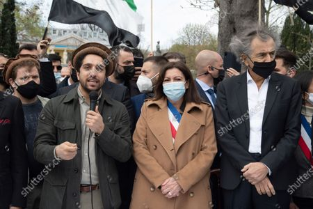 Ahmad Massoud, son of late Afghan commander Ahmad shah Massoud, Paris Mayor Anne Hidalgo, French Author Bernard Henri Levy during a ceremony to unveil a commemorative plaque in his honor along the fields Elysandis Avenue
