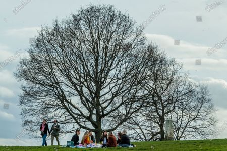 Editorial picture of Fine weather in Hampstead encourages people to meet outdoors a few days before the next stage of the easing of lockdown 3., Hampstead Heath, London, UK - 27 Mar 2021