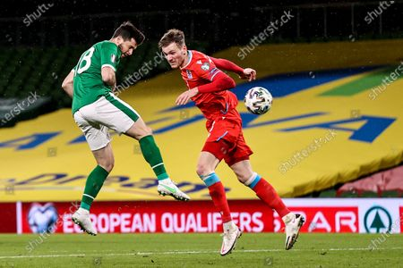 Republic of Ireland vs Luxembourg. Ireland's Shane Long with Christopher Martins of Luxembourg