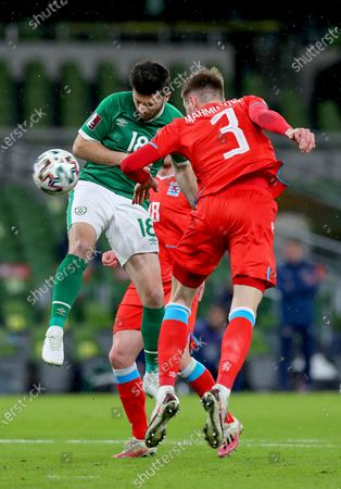 Republic of Ireland vs Luxembourg. Ireland's Shane Long and Enes Mahmutovic of Luxembourg