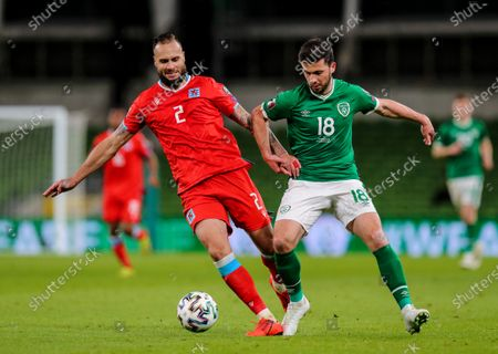 Republic of Ireland vs Luxembourg. Luxembourg's Maxime Chanot and Shane Long of Ireland