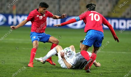 Amar Rahmanovic (C) of Bosnia, and  Bryan Ruiz (R), Yeltsin Tejeda (L) of Costa Rica in action during a friendly soccer match between Bosnia and Herzegovina vs Costa Rica in Zenica, Bosnia and Herzegovina, 27 March 2021.