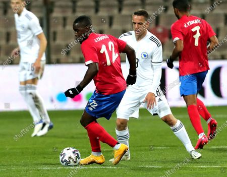 Amir Hadziahmetovic (R) of Bosnia, and  Joel Campbell (L), Yeltsin Tejeda (R) of Costa Rica in action during a friendly soccer match between Bosnia and Herzegovina vs Costa Rica in Zenica, Bosnia and Herzegovina, 27 March 2021.