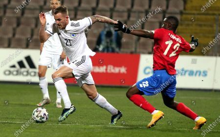Stipe Loncar (L) of Bosnia, and Joel Campbell (R) of Costa Rica in action during a friendly soccer match between Bosnia and Herzegovina vs Costa Rica in Zenica, Bosnia and Herzegovina, 27 March 2021.