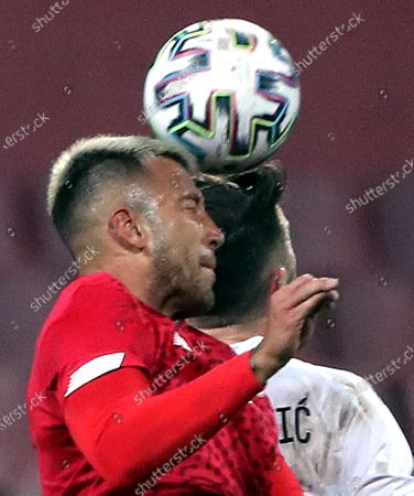 Amar Rahmanovic (R) of Bosnia, and  Francisco Calvo (L) of Costa Rica in action during a friendly soccer match between Bosnia and Herzegovina vs Costa Rica in Zenica, Bosnia and Herzegovina, 27 March 2021.