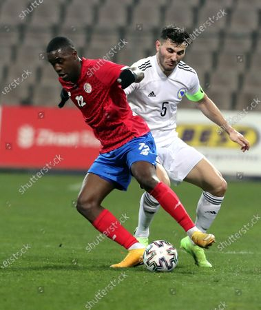 Sead Kolasinac (R) of Bosnia, and Joel Campbell (L) of Costa Rica in action during a friendly soccer match between Bosnia and Herzegovina vs Costa Rica in Zenica, Bosnia and Herzegovina, 27 March 2021.