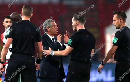 Portugal's head coach Fernando Santos argues with referee Danny Makkelie, centre, during the World Cup 2022 group A qualifying soccer match between Serbia and Portugal at the Rajko Mitic stadium in Belgrade, Serbia