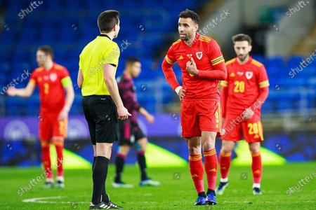 The referee speaks to Wales forward Hal Robson-Kanu (9) during the international friendly match between Wales and Mexico at the Cardiff City Stadium, Cardiff