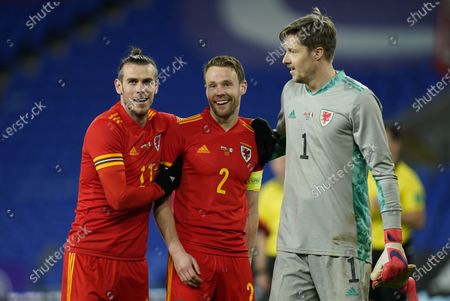 Gareth Bale (L) Chris Gunter (C) and Wayne Hennessey (R) of Wales react at the end of the international friendly match between Wales and Mexico in Cardiff, Britain, 27 March 2021.