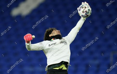 Goalkeeper Guillermo Ochoa of Mexico warms up ahead of the international friendly match between Wales and Mexico in Cardiff, Britain, 27 March 2021.