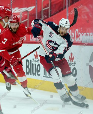 Columbus Blue Jackets defenseman Michael Del Zotto (15) controls the puck as Detroit Red Wings center Michael Rasmussen (27) defends during the second period of an NHL hockey game, in Detroit