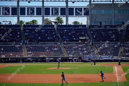 The Toronto Blue Jays take the field during a spring training exhibition baseball game, with a limited number of fans, socially distanced in attendance, against the New York Yankees at George M. Steinbrenner Field in Tampa, Fla