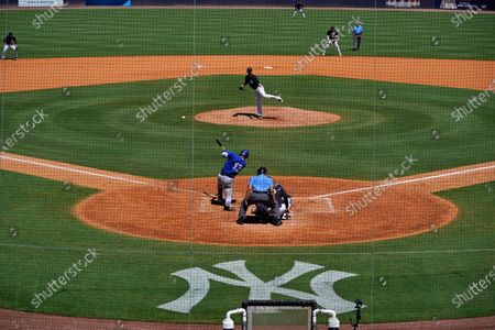 The New York Yankees face the Toronto Blue Jays in a spring training exhibition baseball game, with a limited number of fans, socially distanced in attendance, at George M. Steinbrenner Field in Tampa, Fla