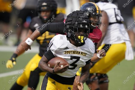 Stock Photo of Southern Mississippi running back Frank Gore Jr. (3) runs upfield against the defense during the team's spring NCAA college football controlled scrimmage in Hattiesburg, Miss