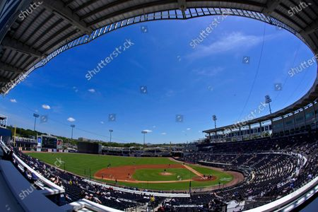 Stock Photo of The New York Yankees face the Toronto Blue Jays in a spring training exhibition baseball game with a limited number of socially distanced fans in attendance at George M. Steinbrenner Field in Tampa, Fla