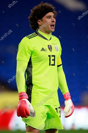 Mexico's goalkeeper Guillermo Ochoa talks to his teammates during a friendly soccer match against Wales at the Cardiff City Stadium, in Cardiff, Wales
