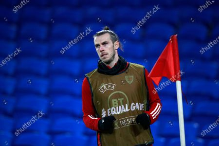 Wales' Gareth Bale warms up during a friendly soccer match against Mexico at the Cardiff City Stadium, in Cardiff, Wales