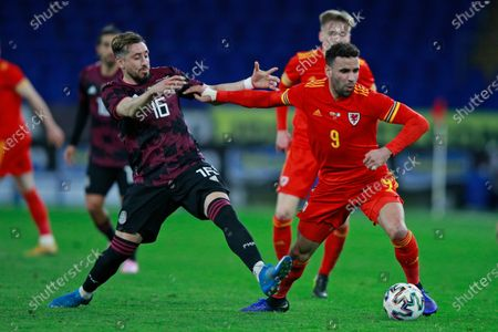 Mexico's Hector Herrera, left, challenges Wales' Hal Robson-Kanu during a friendly soccer match at the Cardiff City Stadium, in Cardiff, Wales