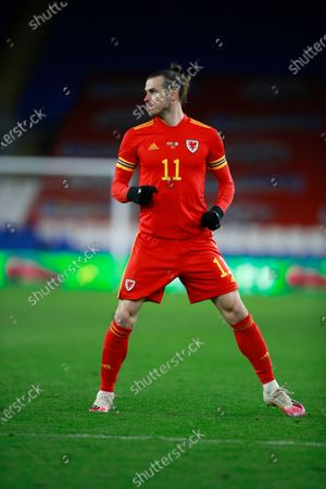 Wales' Gareth Bale stands on the field during a friendly soccer match against Mexico at the Cardiff City Stadium, in Cardiff, Wales