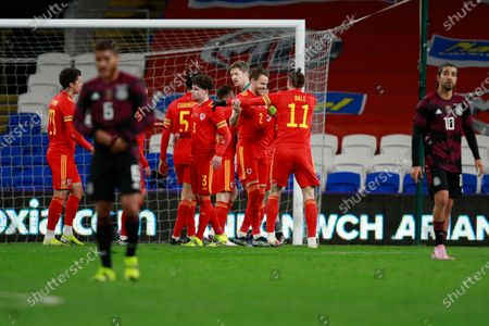 Wales's players celebrate after beating Mexico 1-0 during a friendly soccer match at the Cardiff City Stadium, in Cardiff, Wales