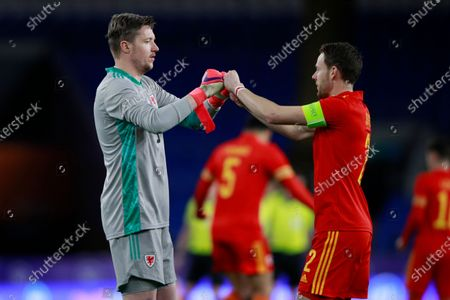 Wales' goalkeeper Wayne Hennessey, left, bumps fists with Chris Gunter prior to a friendly soccer match against Mexico at the Cardiff City Stadium, in Cardiff, Wales