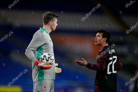 Wales' goalkeeper Wayne Hennessey, left, and Mexico's Hirving Lozano argue during a friendly soccer match at the Cardiff City Stadium, in Cardiff, Wales