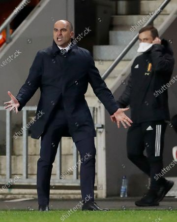Belgium's head coach Roberto Martinez shouts from the touchline during the World Cup 2022 group E qualifying soccer match between Czech Republic and Belgium at the Sinobo stadium in Prague, Czech Republic