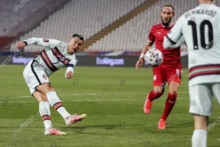 Serbia's Nemanja Gudelj (C) figths for the ball with Portugal's Cristiano Ronaldo during the Group A of FIFA World Cup Qatar 2022 qualifier match at Rajko Mitic Stadium in Belgrade, Serbia, 27th March 2021.
