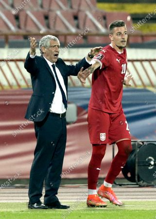 Portugal coach Fernando Santos (L) reacts next to Serbia's Sergej Milinkovic-Savic (R) during the FIFA World Cup 2022 qualifying soccer match between Serbia and Portugal in Belgrade, Serbia, 27 March 2021.