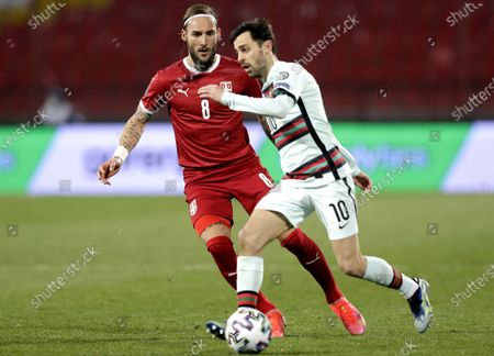 Portugal's Bernardo Silva (R) in action against Serbia's Nemanja Gudelj (L) during the FIFA World Cup 2022 qualifying soccer match between Serbia and Portugal in Belgrade, Serbia, 27 March 2021.