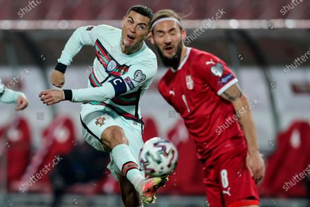 Serbia's Nemanja Gudelj (R) figths for the ball with Portugal's Cristiano Ronaldo during the Group A of FIFA World Cup Qatar 2022 qualifier match at Rajko Mitic Stadium in Belgrade, Serbia, 27th March 2021.
