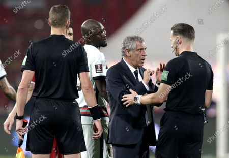 Portugal coach Fernando Santos (2-R) argues with referee Danny Makkelie (R) after the FIFA World Cup 2022 qualifying soccer match between Serbia and Portugal in Belgrade, Serbia, 27 March 2021.