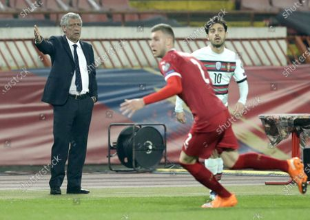 Portugal coach Fernando Santos (L) reacts during the FIFA World Cup 2022 qualifying soccer match between Serbia and Portugal in Belgrade, Serbia, 27 March 2021.