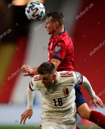 Belgium's Adnan Januzaj (down) in action for a high ball with Jan Boril of Czech Republic (up) during the FIFA World Cup 2022 qualifying soccer match between the Czech Republic and Belgium in Prague, Czech Republic, 27 March 2021.